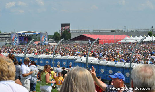 Photo of the Large Crowd Watching ZZ Top in Distance at ...