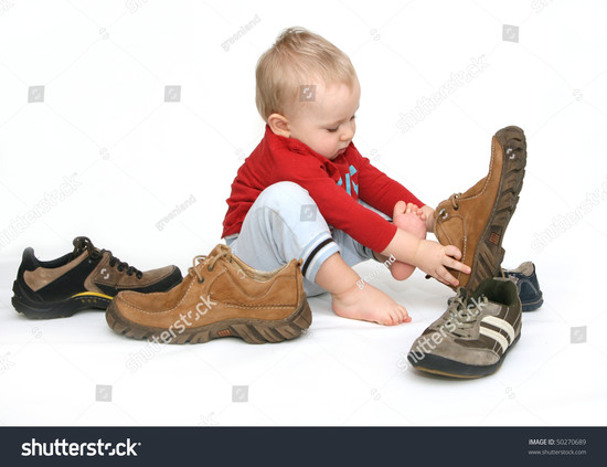 Small Child Tries Put On His Stock Photo 50270689 ...